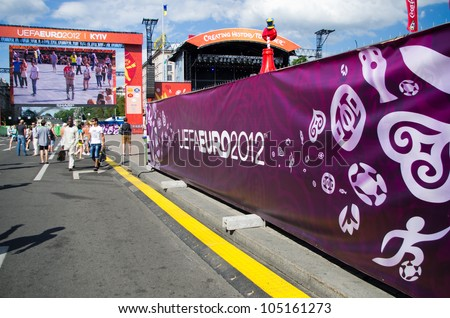 KIEV, UKRAINE - CIRCA JUNE 2012: Official fan zone of EURO-2012 in the central square of Kiev, circa June 2012. EURO 2012 is a European football championship held by UEFA. - stock photo