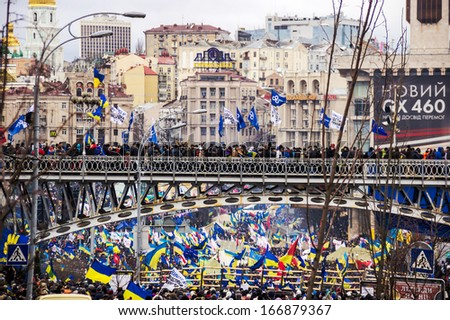 KIEV, UKRAINE, DEC 8, 2013: people at a meeting for the European integration and the resignation of the government in the center of Kiev.  - stock photo