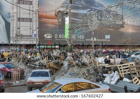 KIEV, UKRAINE - DECEMBER 14: Demonstrators on EuroMaidan guard barricades on Khreshchatyk street during protests against the Ukrainian president and government on December 14, 2013 in Kiev, Ukraine. - stock photo