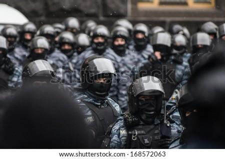 "KIEV, UKRAINE - DECEMBER 8: group of ""Berkut"" ,military special forces, defend the presidential palace on December 8, 2013 in Kiev, Ukraine.  - stock photo"