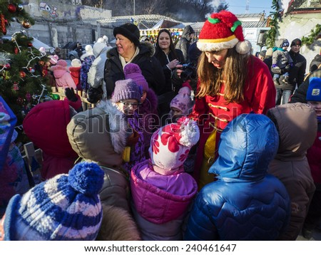 KIEV, UKRAINE - December 29, 2014: Kiev volunteers organized for children from the Donetsk and Luhansk oblasts Christmas. Volunteers are invited to almost 2,000 children and their parents. - stock photo