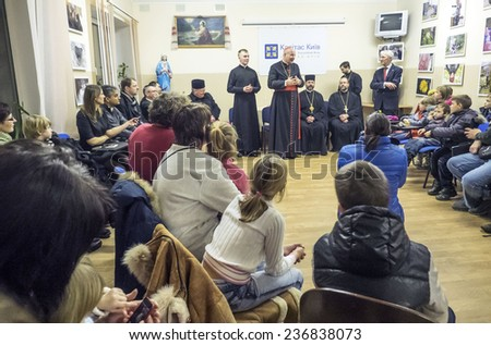 KIEV, UKRAINE - December 11, 2014: Papal envoy Bishop of Vienna Cardinal Christoph Schoenborn visited center of charity organization Caritas, where he met with IDPs from eastern regions of Ukraine.  - stock photo