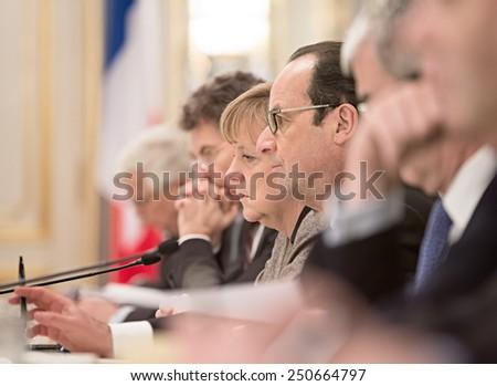 KIEV, UKRAINE - Feb 5, 2015: French President Francois Hollande and Chancellor of the Federal Republic of Germany Angela Merkel during a meeting with the President of Ukraine, Pyotr Poroshenko - stock photo