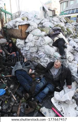 KIEV, UKRAINE - FEBRUARY 18, 2014: Dead people on the barricades after police attack. Kiev, Ukraine, 18.02.2014 - stock photo