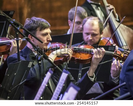 KIEV, UKRAINE - February 19, 2015: Dress rehearsal of the National Symphony Orchestra of Ukraine, conducted by Vladimir Sirenko in preparation for the celebrations  of the Revolution Advantages - stock photo