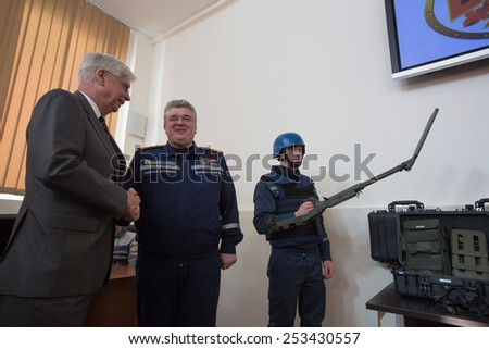 KIEV, UKRAINE - FEBRUARY, 17, 2015: Head of the State Service for Emergency Situations Serhii Bochkovskii and German Ambassador to Ukraine Christof Weil during the transfer 50 mines detectors - stock photo