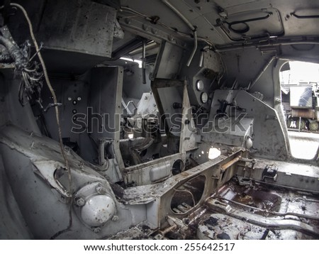"KIEV, UKRAINE - February 21, 2015: In the cab of the Russian BTR-80 downed in eastern Ukraine at documentary exhibition ""Presence"", which shows evidence of Russian aggression against Ukraine. - stock photo"
