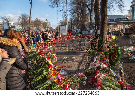 KIEV, UKRAINE - February 24, 2014: Mass anti-government protests in Kiev, Ukraine. Kiev after two days of violent clashes between riot police and Euromaidan protesters. - stock photo