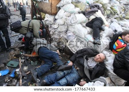 KIEV, UKRAINE - FEBRUARY 18, 2014: People lie dead on the barricades near Khreschatyk Metro. Kiev, Ukraine, Street Institutskaja, 18.02.2014 - stock photo