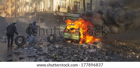 Kiev, Ukraine - February 18, 2014: Protesters march went peacefully to the street Institutskaya Lipsky, Shelkovichnaya-to cabinet, parliament, but were met by riot police. A fight broke out.  - stock photo