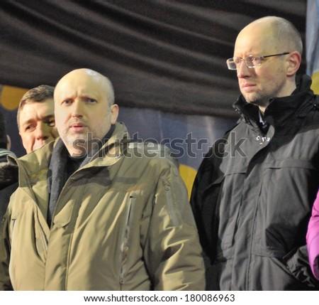 KIEV, UKRAINE - 26 FEBRUARY 2013: The Ukrainian politicians O.Turchinov and A.Yatsenuk speak on the meeting on February 26, 2013 in Kiev, Ukraine. - stock photo