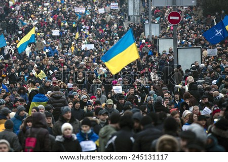 """KIEV, UKRAINE - Jan 18, 2015: Banners """"I Volnovaha"""" and the lamps on Independence Square during the march of solidarity against terrorism and memory of victims of terrorist attack in Volnovakha - stock photo"""