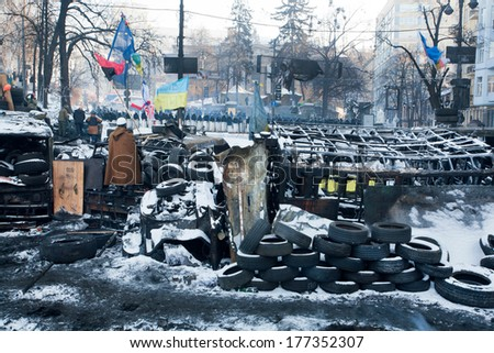 KIEV, UKRAINE - JAN 29: Barricades of tires and scrap erected opposite the police force on the bombed street in government quarter during winter anti-government protest on January 29, 2014, in Kyiv - stock photo