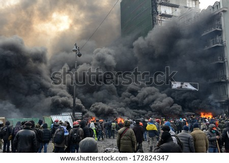KIEV, UKRAINE - JANUARY 23, 2014: Anti-government protest in Kiev,  Grushevsky str.  People defend barricades. - stock photo