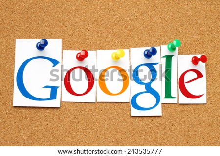 KIEV, UKRAINE - JANUARY 10, 2015:Google logotype printed on paper, cut and pinned on cork bulletin board.Google is USA multinational corporation specializing in Internet-related services and products. - stock photo