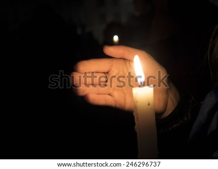 KIEV, UKRAINE - January 22, 2015: In Kiev, honored the memory the victims of the first activists Euromaidan. A girl holds a candle.  - stock photo