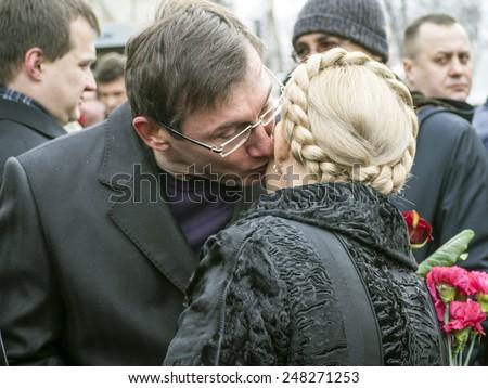 KIEV, UKRAINE - January 29, 2015: Leaders of political parties Block Yuriy Lutsenko Poroshenko welcomes Yulia Tymoshenko. Ukrainian politicinas attended the ceremony Kruty Heroes, - stock photo