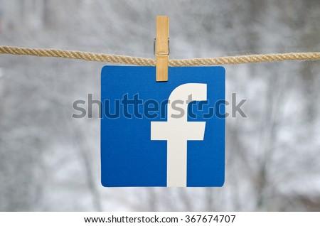 Kiev, Ukraine - January 26, 2016: Popular social media Facebook hanging on the clothesline, against the backdrop of a winter landscape. - stock photo