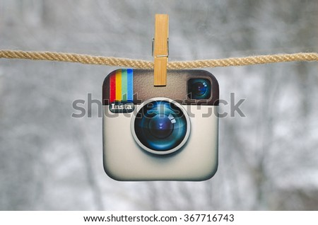 Kiev, Ukraine - January 26, 2016: Popular social media instagram hanging on the clothesline, against the backdrop of a winter landscape. - stock photo