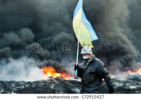 KIEV, UKRAINE - 23 JANUARY 2014: Unknown demonstrators at the Independence square during Ukrainian revolution on January 23, 2014 in Kiev, Ukraine. - stock photo