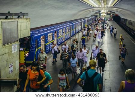 Kiev, Ukraine - July 26, 2015. Passengers on a subway station in Kiev - stock photo