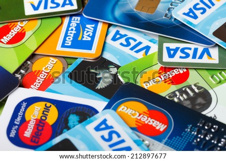 KIEV, UKRAINE - July 7: Pile of credit cards, Visa and MasterCard, credit, debit and electronic, in Kiev, Ukraine, on July 7, 2014. - stock photo
