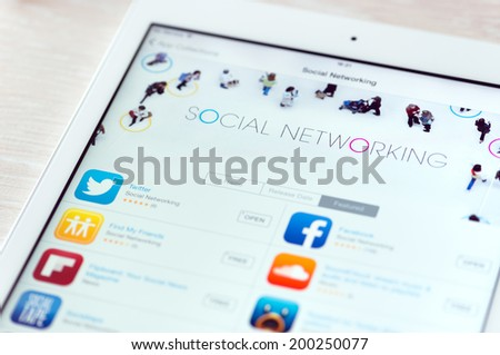 KIEV, UKRAINE - JUNE 05, 2014: Brand new Apple iPad Air with featured social networking app in App Store collection. App Store is a digital distribution service for mobile apps, developed by Apple Inc - stock photo