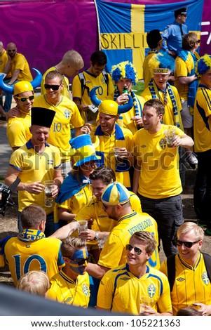 KIEV, UKRAINE - JUNE 15: Sweden and Ukrainian fans arrive in the fanzone before match Euro 2012 between England - Sweden on June 15, 2012 in Kiev, Ukraine. Zone for the fans UEFA EURO Championship. - stock photo