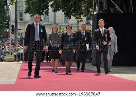 KIEV, UKRAINE - 08 JUNE 2014: The prime minister of Latvia Laimdota Straujuma with security visit the inauguration of Ukrainian President Petro Poroshenko on June 08, 2014 in Kiev, Ukraine - stock photo