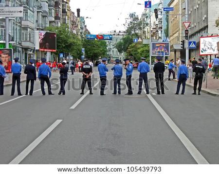 KIEV, UKRAINE - JUNE 15: Ukrainian police cordon in Kiev before match England-Sweden on June 15, 2012 in Kiev, UKRAINE. EURO 2012 football championship started on June 08 in Ukraine and Poland. - stock photo