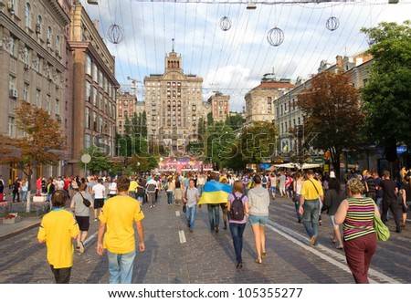 KIEV, UKRAINE - JUNE 15: Ukrainian, Swedish and English fans go to fanzone before match Euro 2012 between Ukraine - France and England - Sweden on June 15, 2012 in Kiev, Ukraine. Zone for fans EURO - stock photo