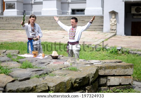 KIEV,UKRAINE - JUNE 1:unidentified ukrainian pagan community making ritual ceremony dedicated to Perun,Slavic god of Thunder,near National Museum of History on June 1,2014 in Kiev,Ukraine  - stock photo