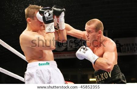 KIEV, UKRAINE - JUNE 19,: Vyacheslav Uzelkov (R) fights with Berlin-based Slovenian Denis Simcic for the WBA Intercontinental light heavyweight champion belt on June 14, 2008 in Kiev, Ukraine - stock photo