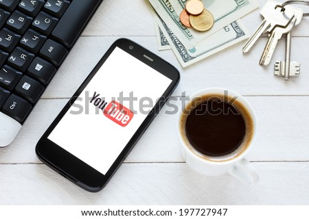 KIEV, UKRAINE - June 9: YouTube platform logo on new smartphone, in Kiev, Ukraine, on June 9, 2014. - stock photo
