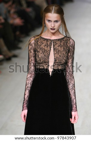 """KIEV, UKRAINE - MAR 17: Model poses at the runway during Fashion Show by """"ANDRE TAN"""" by fashion designer of Andre Tan as part of Ukrainian Fashion Week, March 17, 2012 in Kiev, Ukraine. - stock photo"""