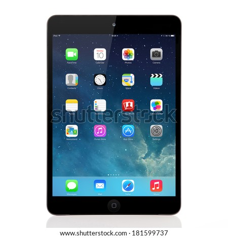 Kiev, Ukraine- March 10, 2014:Apple iPad mini displaying iOS 7.1 homescreen. iOS 7.1 operating system designed by Apple Inc. official output 10 March 2014. iPad mini is a tablet produced by Apple Inc. - stock photo
