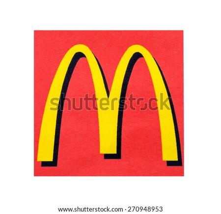 KIEV, UKRAINE - MARCH 31, 2015: McDonal's Logo printed on paper and placed on white background. The McDonald's Corporation is the world's largest chain of hamburger fast food restaurants. - stock photo