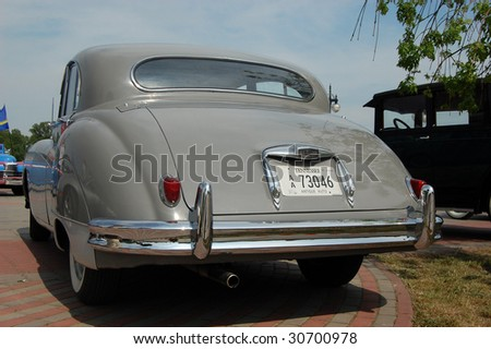 KIEV, UKRAINE - MAY 22: A classic Jaguar car is shown at an exhibition of retro cars at the Auto Show 2009 on May 22, 2009 in Kiev. The show took place from May 22-24. - stock photo