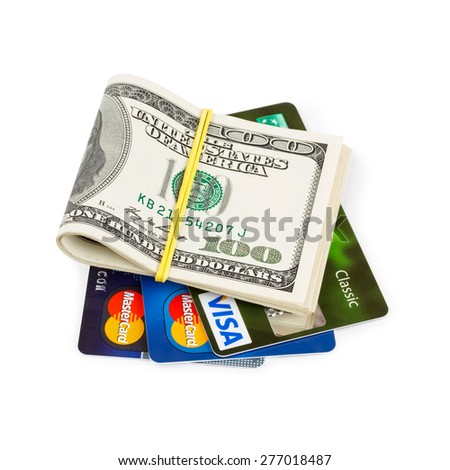KIEV, UKRAINE - May 18: Dollar bills folded and tied, with credit cards Visa and two MasterCard, in Kiev, Ukraine, on May 18, 2014. - stock photo