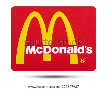 KIEV, UKRAINE - MAY 13, 2015: fast food chain McDonald's   printed on paper and placed on white background.  It is the world's largest chain of hamburger fast food restaurants. - stock photo