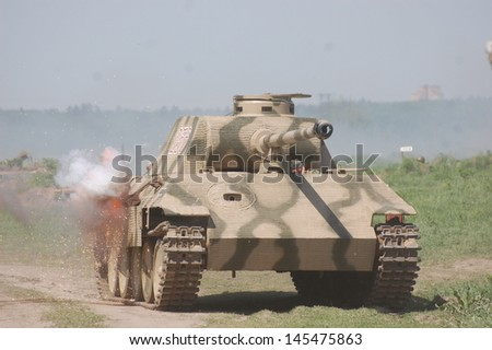 KIEV, UKRAINE - MAY 11 : German tank (replica), Red Star history club, during historical reenactment of WWII on May 11, 2013 in Kiev, Ukraine  - stock photo