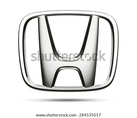 KIEV, UKRAINE - MAY 13, 2015:Honda logotype printed on paper and placed on white background. Honda international industrial company for the production of cars and motorcycles. - stock photo