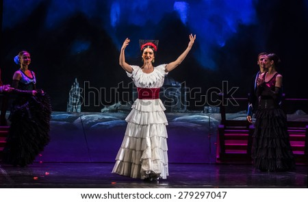 "KIEV, UKRAINE - MAY 13, 2015: Kyiv National Operetta Theatre showed the ballet ""Carmen Suite"" directed by Vadim Prokopenko. - stock photo"