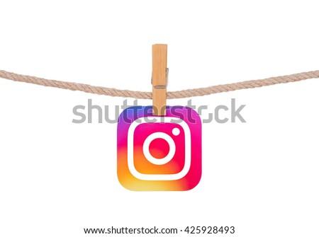 Kiev, Ukraine - May 24, 2016: Popular social media Instagram logotype  hanging on the clothesline isolated on white background. - stock photo