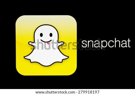 KIEV, UKRAINE - MAY 21, 2015: Snapchat logo  on pc screen.  Snapchat is popular a photo messaging application. - stock photo