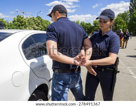 KIEV, UKRAINE - MAY 16, 2015: Students of Institute for Police training Ukraine on practical exercises.  Training of future police officers conducted by experienced Ukrainian and American instructors. - stock photo