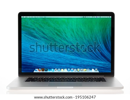 KIEV, UKRAINE - MAY 16, 2014: Studio shot of brand new Apple MacBook Pro with Retina Display, a third generation in MacBook series, designed and developed by Apple inc. in October 22, 2013. - stock photo