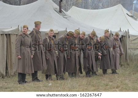KIEV, UKRAINE -NOV 3 An unidentified members of Red Star history club wear historical Soviet uniform during historical reenactment of WWII, Dnepr river crossing 1943, November 3, 2013 Kiev, Ukraine  - stock photo