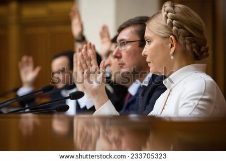 KIEV, UKRAINE - NOV 27, 2014: People's deputies of Ukraine Yuriy Lutsenko and Yulia Tymoshenko at the opening of the first session of the Verkhovna Rada of Ukraine VIII convocation - stock photo