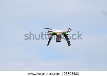 KIEV, UKRAINE -NOV 3: Quadrocopter drone flies with mounted digital camera during historical reenactment of WWII, Dnepr river crossing 1943, November 3, 2013 . Kiev, Ukraine  - stock photo